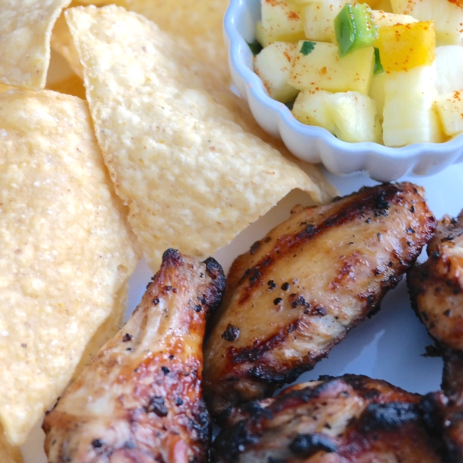 Spicy Grilled Chicken Wings with Tropical Salsa are a bit fiery and a lot delicious! Serve with some tortilla chips and give your taste buds a fiesta!