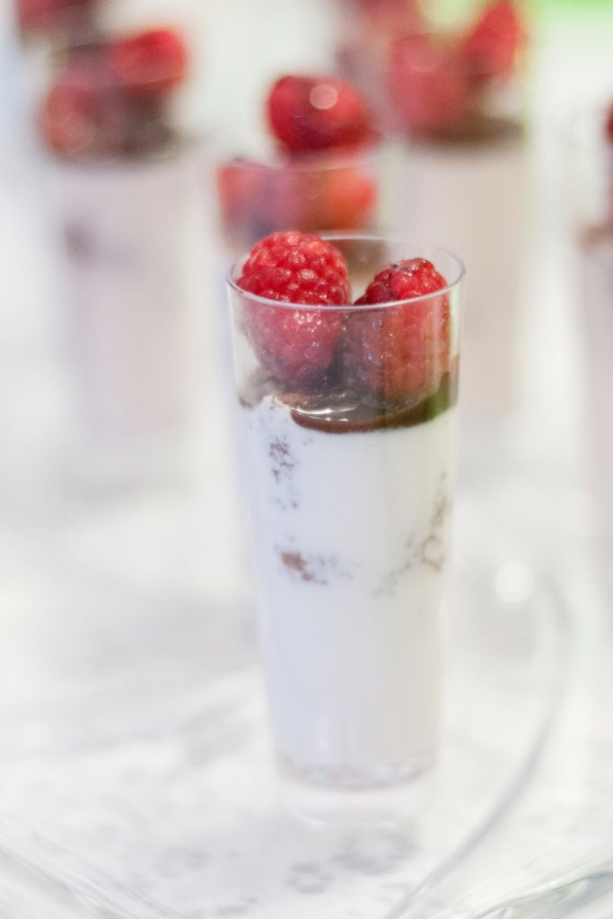 Easy Raspberry Dream Mini Parfaits begin with bites of chocolate cake mingled with creamy Italian custard, fresh raspberries and a touch of chocolate syrup.