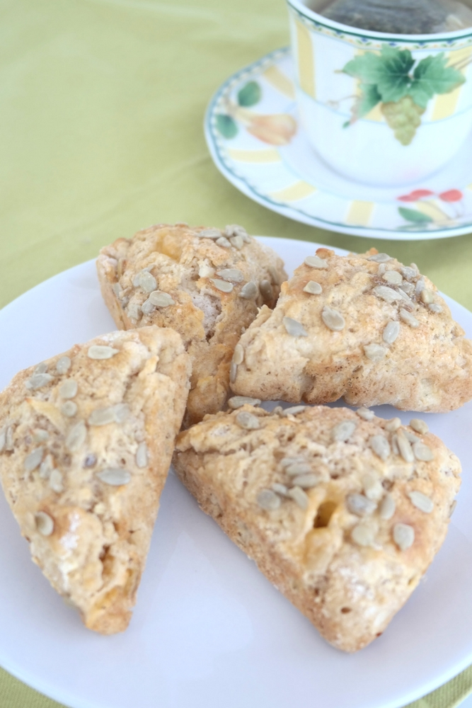 Fresh Apple and Cheese Scones are baked with bits of fresh apple and cheese, and a touch of crunchy sunflower seeds. Perfect for tea time or breakfast!