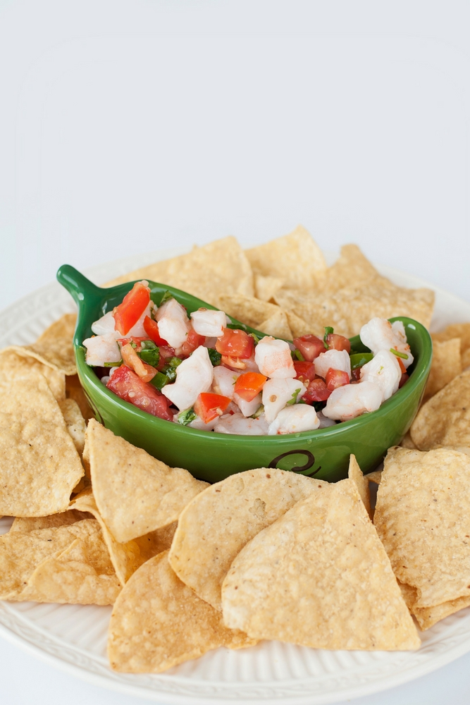Easy Shrimp Dip is bursting with fresh flavors and textures. Whether it's served with tortilla chips, filling for tacos or on its own it's always a hit