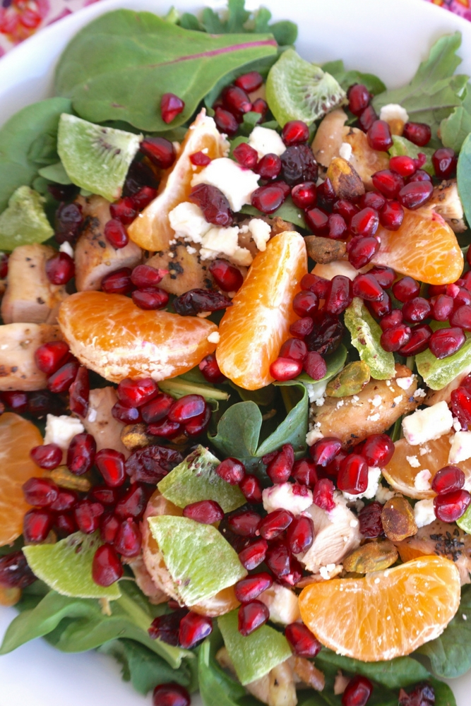 Lots of flavors and vibrant colors make this holiday salad one you'll want to enjoy throughout the year! It's a fresh and healthy main entree salad.